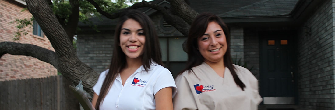 Caregivers smiling outside of a facility