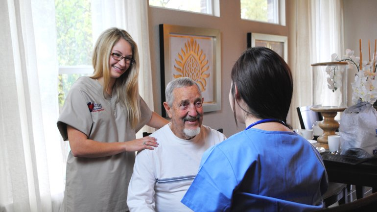 CG and Senior Male Talking with Nurse