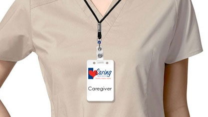 Close up of Caregiver uniform with badge
