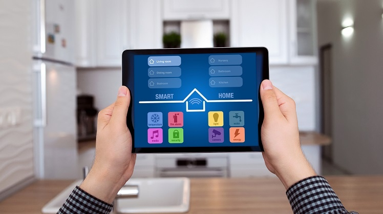 Male hands holding tablet with smart home app controls