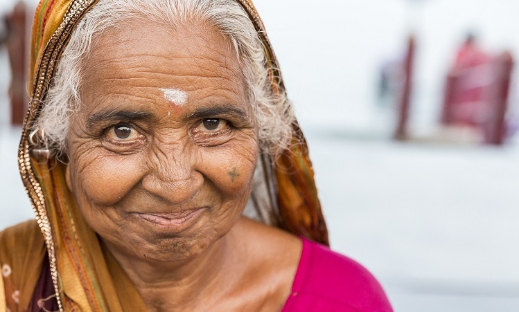 Senior Indian woman smiling wearing traditional sari