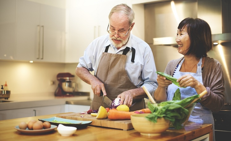 Senior couple cooking in the kitchen LR