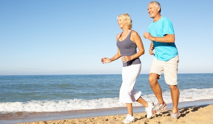 Senior Couple Jogging along the beach