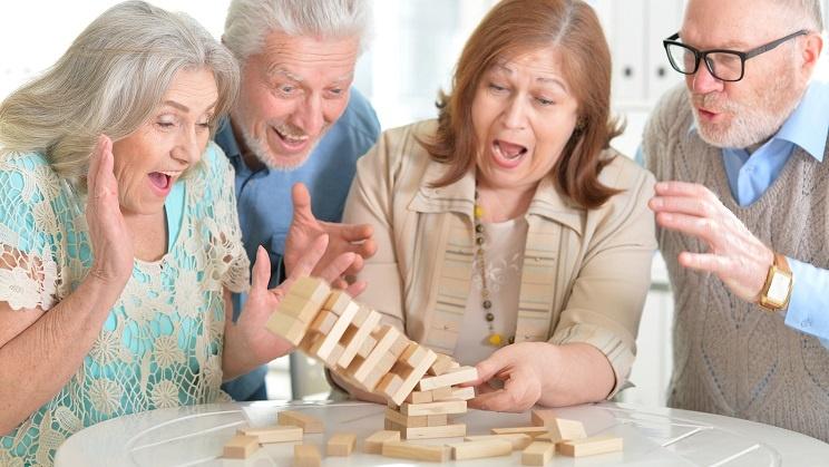 Senior couples playing game called Jenga