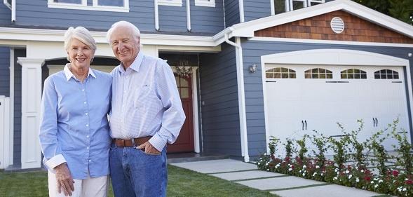 Senior couple outside their home