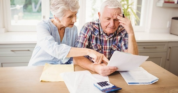 Senior couple going over finances and taxes