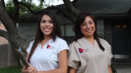 Smiling caregivers in front of facility