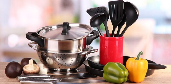 Kitchen pots and utensils with vegetables