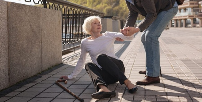 Elderly lady on the sidewalk from a fall needing fall prevention care