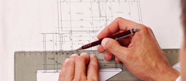Architect drawing on page with ruler