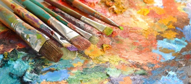Art paint brushes on top of pallette