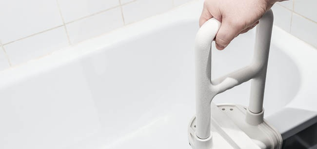 Hand on shower handle