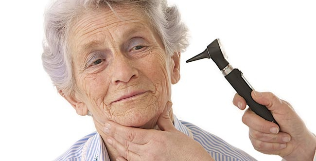 Elderly woman getting ears examined