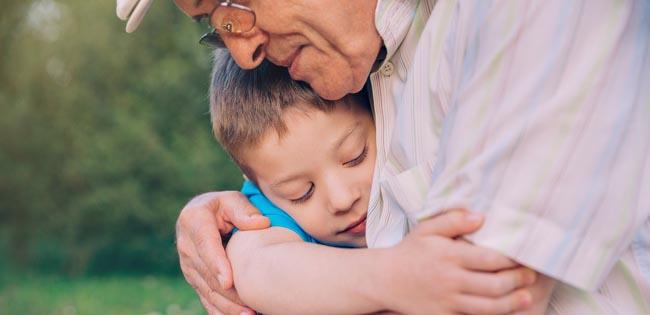 Grandpa hugging grandson