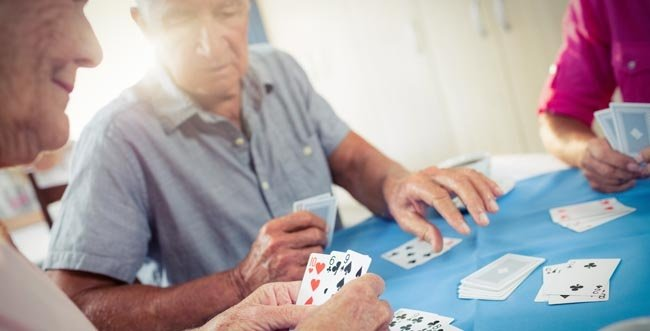 Seniors playing a card game