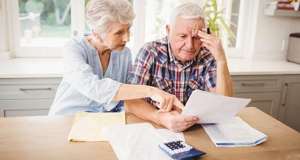 Senior couple going over financial records