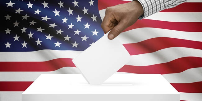 Hand putting ballot into voting box